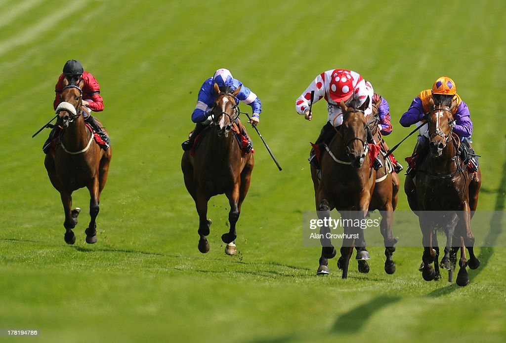 Paul Hanagan riding Imshivalla (red cap) win The JRA Nursery Handicap Stakes at Epsom racecourse on August 27, 2013 in Epsom, England.