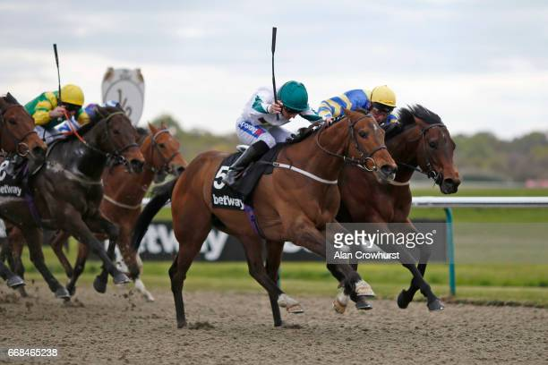 Paul Hanagan riding Kimberella win The Betway AllWeather Sprint Championships Conditions Stakes during The All Weather Championships Finals Day at...