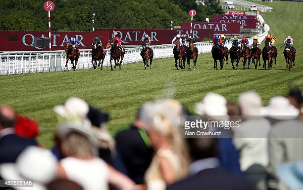 Paul Hanagan riding Muthmir win The Qatar King George Stakes at Goodwood racecourse on July 31 2015 in Chichester England