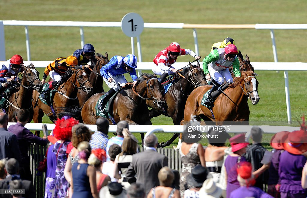 Paul Hanagan riding Qawaasem (C, blue&white) win Three Chimneys EBF Maiden Fillies' Stakes at Newmarket racecourse on July 11, 2013 in Newmarket, England.