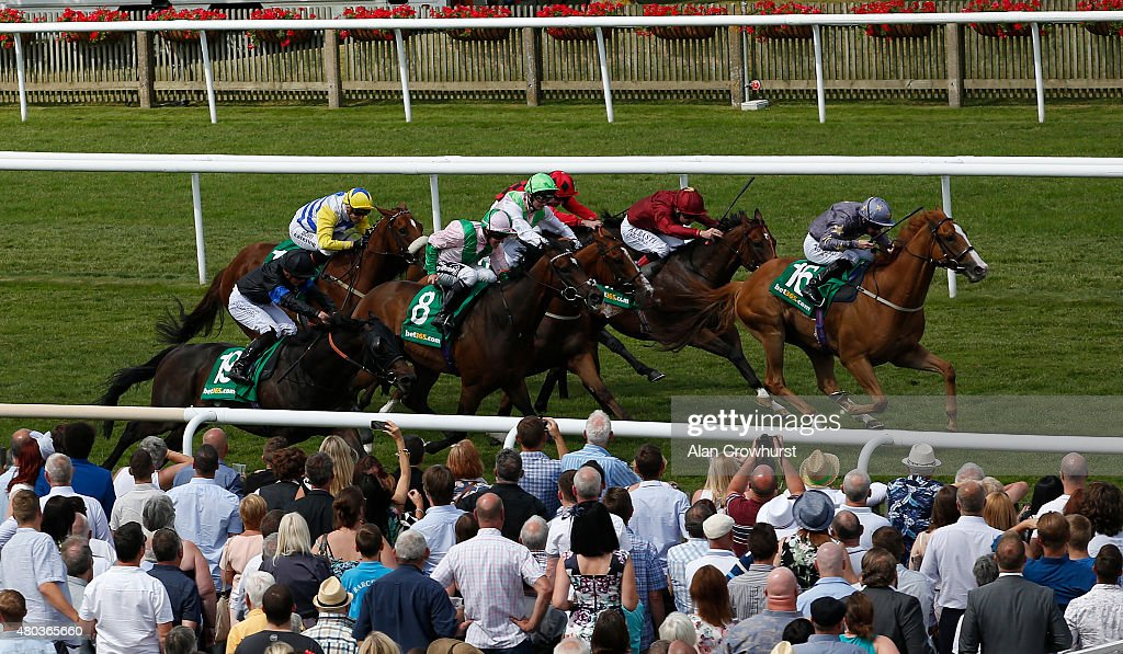 Paul Hanagan riding Rene Mathis wins The bet365 Bunbury Cup at Newmarket racecourse on July 11 2015 in Newmarket England
