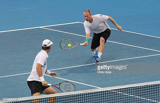 Paul Hanley of Australia and Lukas Dlouhy of Czech Republic compete in the Men's doubles final match against Robert Lindstedt of Sweden and Horia...