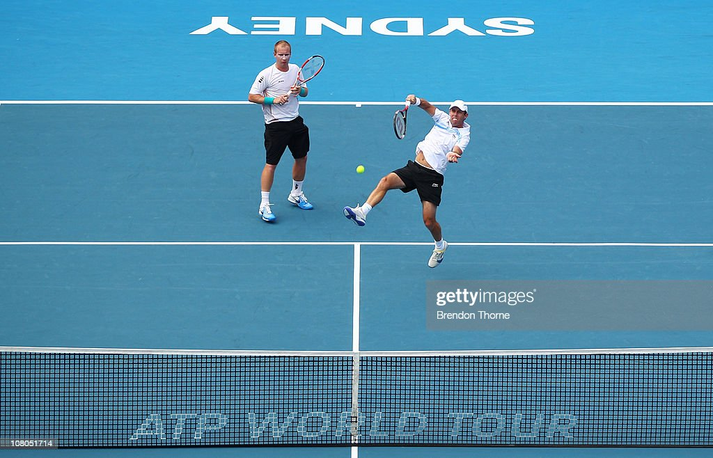 Paul Hanley of Australia and Lukas Dlouhy of the Czech Republic volley in their Mens doubles final against Bob and Mike Bryan of the USA during day...