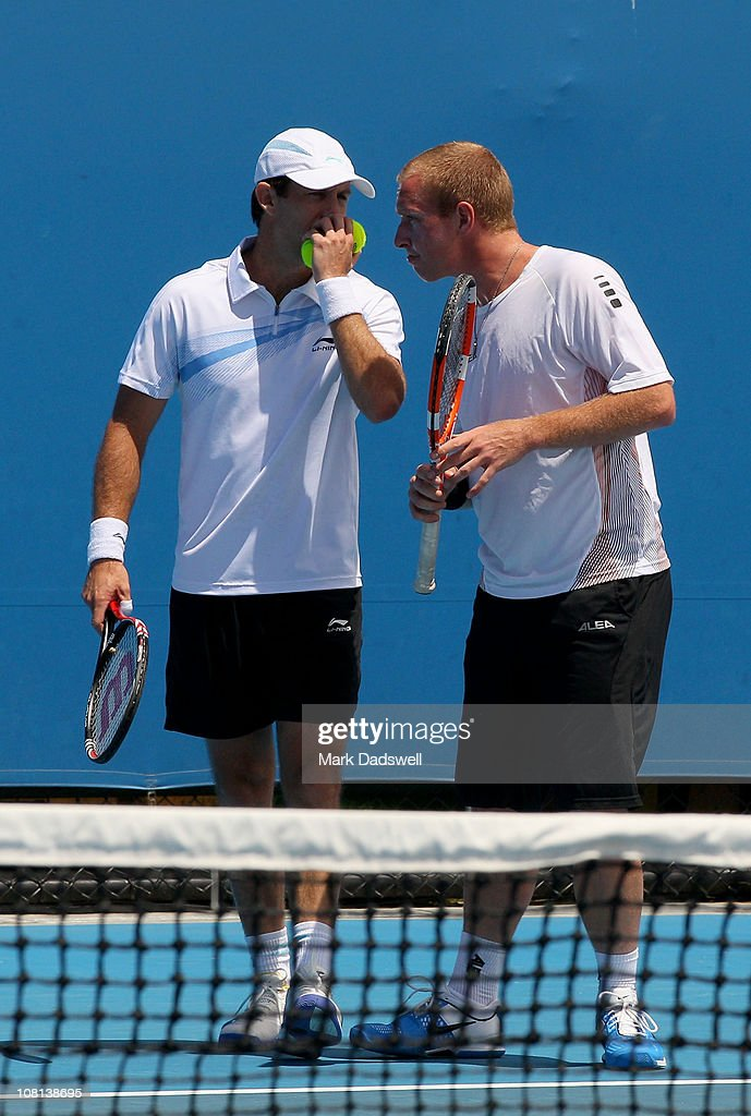 Paul Hanley of Australia and Lukas Dlouhy of the Czech Republic talk tactics in their first round doubles match against David Marrero and Ruben...