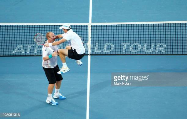 Paul Hanley of Australia jumps on team mate Lukas Dlouhy of the Czech Republic after winning the Mens doubles final against Bob and Mike Bryan of the...