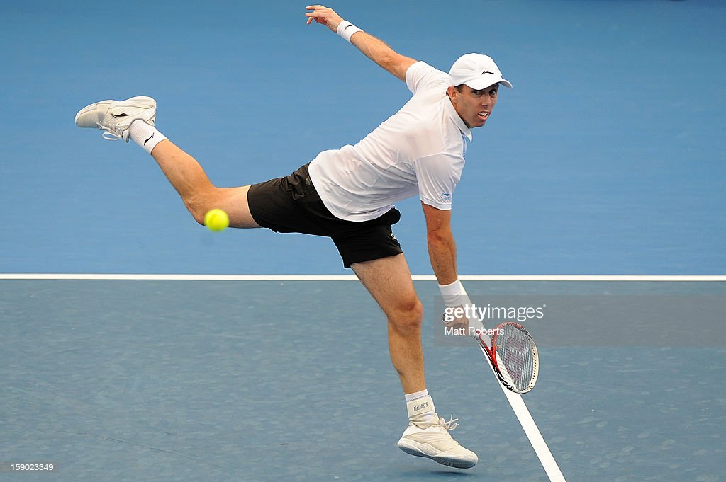 Paul Hanley plays a backhand during his doubles final match partnered with Eric Butorac against Marcelo Melo and Tommy Robredo on day eight of the Brisbane International at Pat Rafter Arena on January 6, 2013 in Brisbane, Australia.
