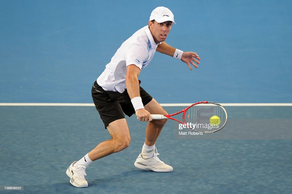 Paul Hanley plays a backhand in his doubles match with Eric Butorac against Lleyton Hewitt and Chris Guccione during day one of the Brisbane International at Pat Rafter Arena on December 30, 2012 in Brisbane, Australia.