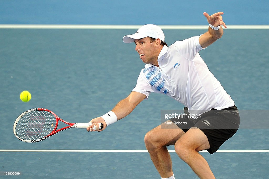 Paul Hanley plays a forehand in his doubles match with Eric Butorac against Lleyton Hewitt and Chris Guccione during day one of the Brisbane International at Pat Rafter Arena on December 30, 2012 in Brisbane, Australia.