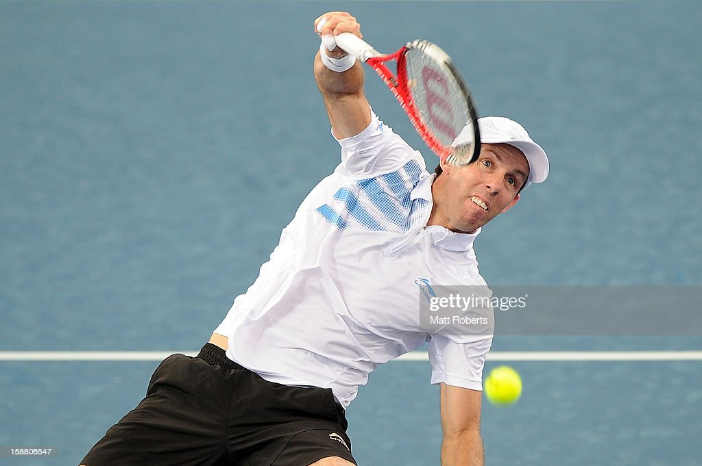 Paul Hanley plays a shot in his doubles match with Eric Butorac against Lleyton Hewitt and Chris Guccione during day one of the Brisbane International at Pat Rafter Arena on December 30, 2012 in Brisbane, Australia.