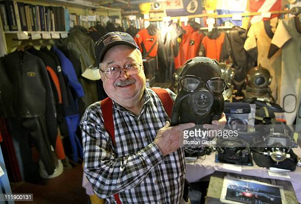 Paul Harling with dive mask he made from a navy gas mask in the Dive Locker an exhibit of historical diving gear at the Gloucester Maritime Heritage...