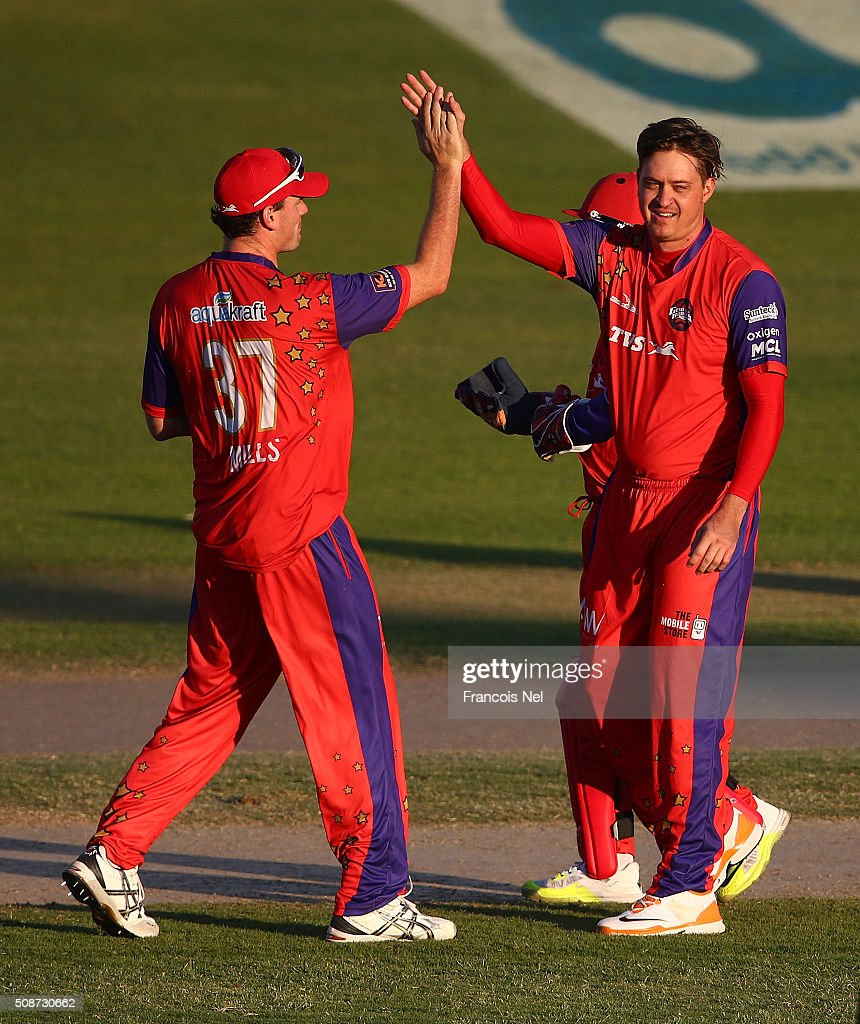 Paul Harris of Gemini celebrates taking the wicket of Owais Shah of Virgo with his team-mate <a gi-track='captionPersonalityLinkClicked' href=/galleries/search?phrase=Kyle+Mills&family=editorial&specificpeople=647054 ng-click='$event.stopPropagation()'>Kyle Mills</a> (L) during the Oxigen Masters Champions League match between Gemini Arabians and Virgo Super Kings on February 6, 2016 in Sharjah, United Arab Emirates.