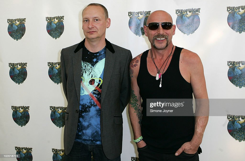 Paul Hartnoll and Phil Hartnoll of Orbital pose back stage during day two of the Isle of Wight Festival 2010 at Seaclose Park on June 12 2010 in...