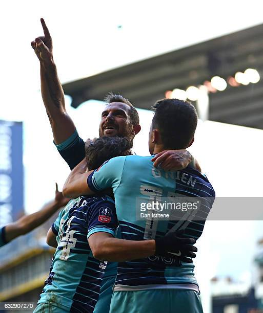 Paul Hayes of Wycombe Wanderers celebrates with team mates after scoring his sides second goal during the Emirates FA Cup Fourth Round match between...