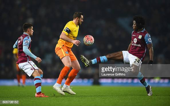 Paul Hayes of Wycombe Wanderers controls the ball under pressure of Ashley Westwood and Carlos Sanchez of Aston Villa during the Emirates FA Cup...