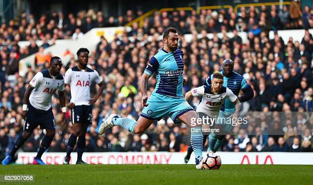 Paul Hayes of Wycombe Wanderers scores his sides second goal from the penalty spot during the Emirates FA Cup Fourth Round match between Tottenham...