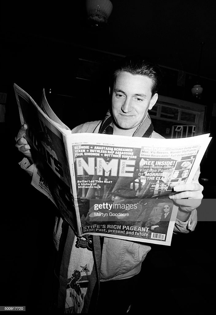 Paul Heaton of Beautiful South reading a copy of music magazine the NME United Kingdom March 1991