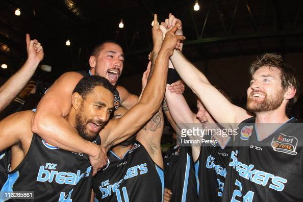 Paul Henare Mika Vukona and Dillon Boucher of the Breakers celebrate with the team after winning game three of the NBL Grand Final series between the...