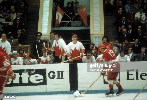 Paul Henderson and Phil Esposito of Canada look on from the bench during the 1972 Summit Series against the Soviet Union in September 1972 at the...