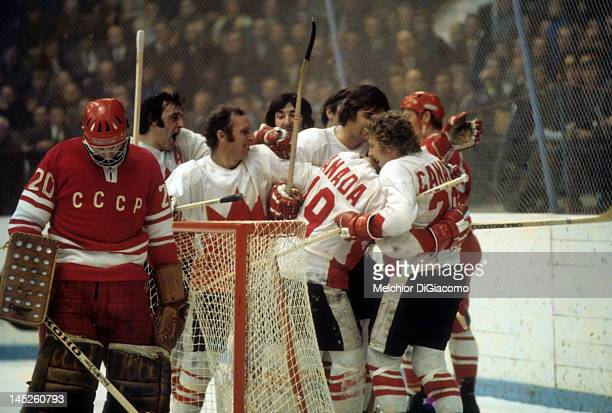Paul Henderson of Canada celebrates with teammates after scoring the gamewinning goal against goalie Vladislav Tretiak of the Soviet Union during...