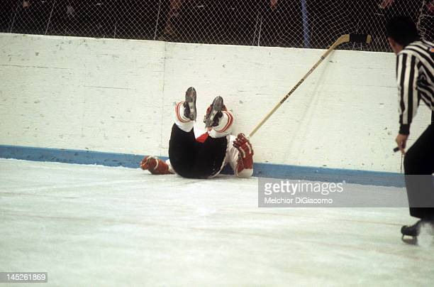 Paul Henderson of Canada crashes into the boards during Game 5 of the 1972 Summit Series on September 22 1972 at the Luzhniki Ice Palace in Moscow...
