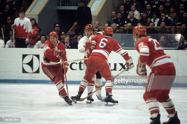 Paul Henderson of Canada is checked by Vladimir Shadrin and Valeri Vasiliev of the Soviet Union during the 1972 Summit Series at the Luzhniki Ice...
