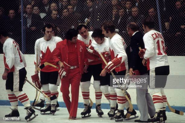 Paul Henderson of Canada is helped to the bench by trainer Joe Sgro and teammates Frank Mahovlich and Rod Seiling during Game 5 of the 1972 Summit...