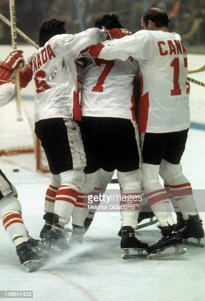 Paul Henderson of Canada is surrounded by celebrating teammates Ron Ellis Phil Esposito and Bill White after scoring the serieswinning goal during...