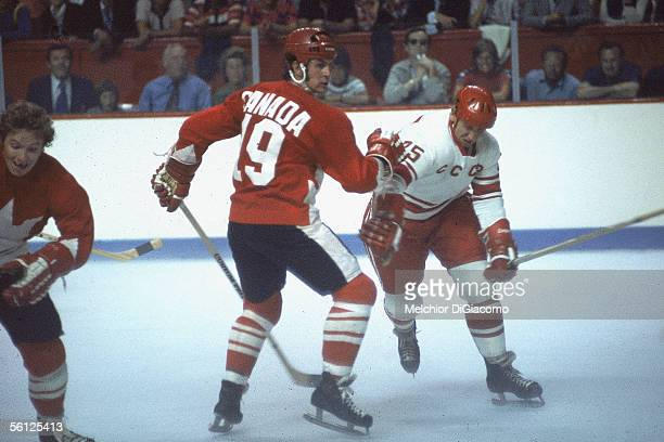 Paul Henderson of Team Canada checks Yuri Liapkin of the Soviet Union during Game 1 of the 1972 Summit Series on September 2 1972 at the Montreal...