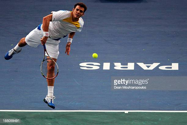 Paul Henri Mathieu of France in action against Andy Murray of Great Britain during day 3 of the BNP Paribas Masters at Palais Omnisports de Bercy on...