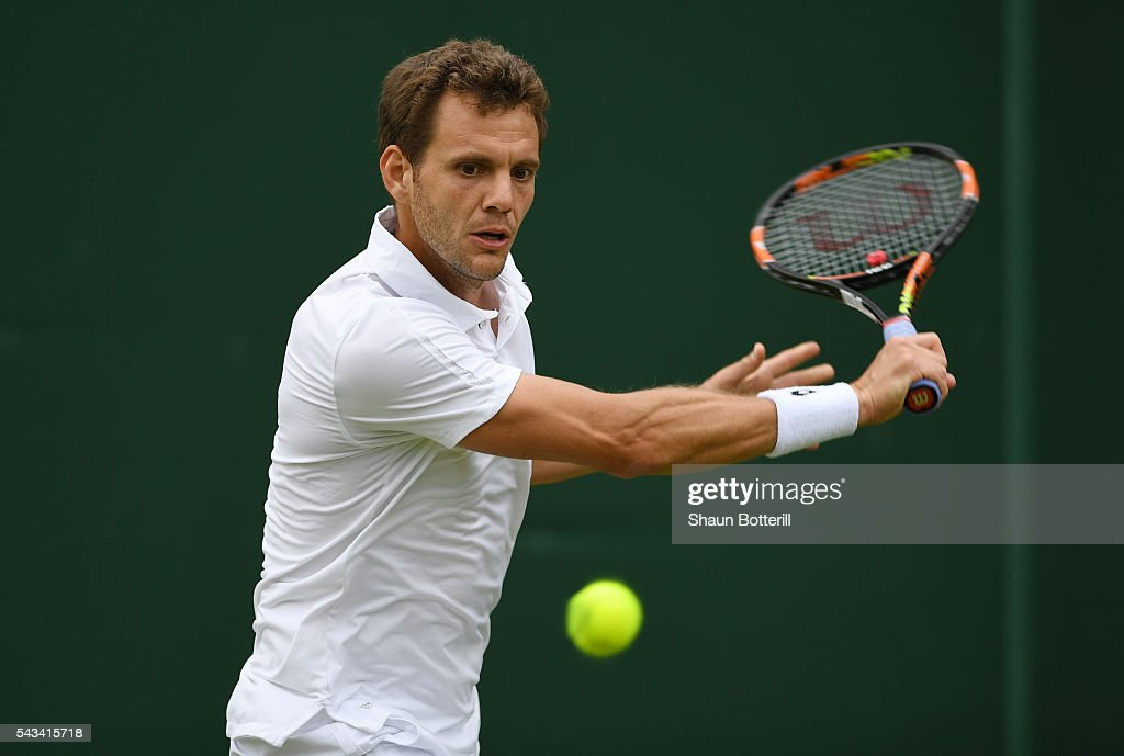 Paul Henri-Mathieu of France plays a backhand during the Men's Singles first round match against Alexander Averev of Germany on day two of the Wimbledon Lawn Tennis Championships at the All England Lawn Tennis and Croquet Club on June 28, 2016 in London, England.