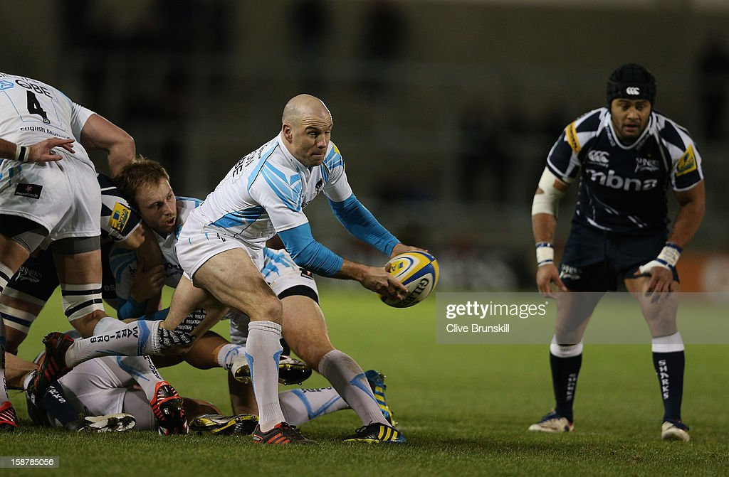 Paul Hodgson of Worcester Warriors clears the ball from the scrum watched by Sam Tuitupou of Sale Sharks during the Aviva Premiership match between Sale Sharks and Worcester Warriors at Salford City Stadium on December 28, 2012 in Salford, England.