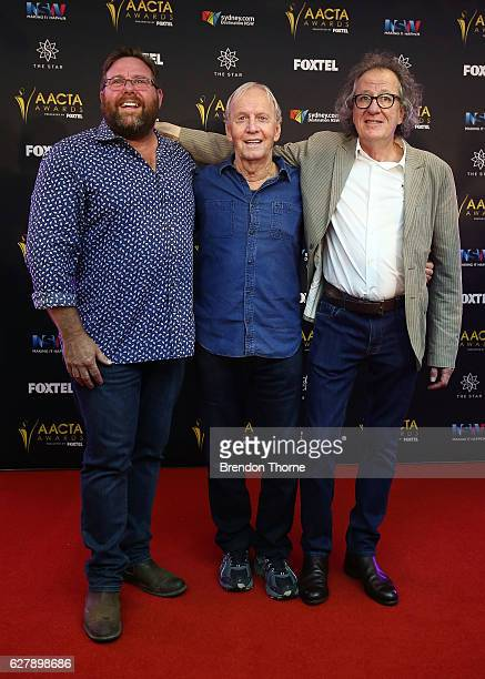 Paul Hogan Shane Jacobson and Geoffrey Rush pose after Paul Hogan is announced as the 2016 AACTA Longford Lyell Award recipient at Dawes Point Park...