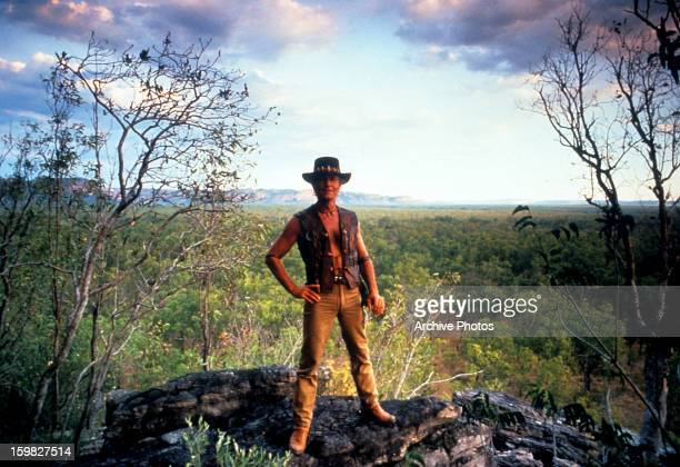 Paul Hogan standing on rock in a scene from the film 'Crocodile Dundee' 1986