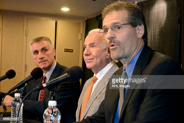Paul Holmgren and team chairman Ed Snider listen in as Ron Hextall speaks during a press conference The Philadelphia Flyers announced the promotion...
