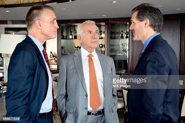 Paul Holmgren team chairman Ed Snider and Ron Hextall speak before a press conference The Philadelphia Flyers announced the promotion of Paul...