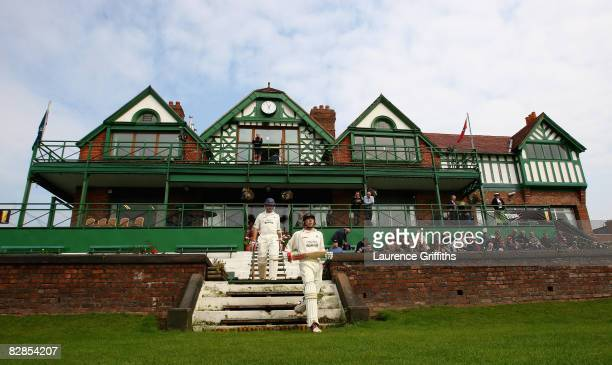 Paul Horton and Mark Chilton of Lancashire walk out to bat in front of the old pavilion at start of play during the LV County Championship Match...