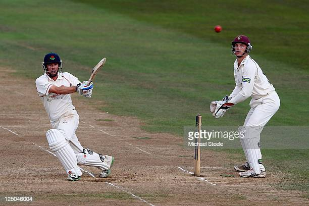 Paul Horton of Lancashire pulls to the legside as wicketkeeper Jos Buttler looks on during the LV County Championship match between Somerset and...