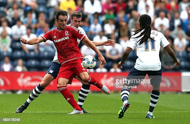 Paul Huntington of Preston North End in action with Kike of Middlesbrough during the Sky Bet Championship match between Preston North End and...