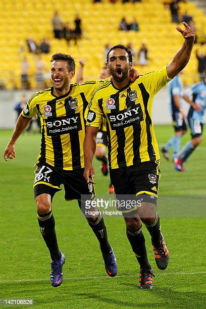 Paul Ifill and Vince Lia of the Phoenix celebrate the winning goal during the ALeague Elimination Final match between the Wellington Phoenix and...