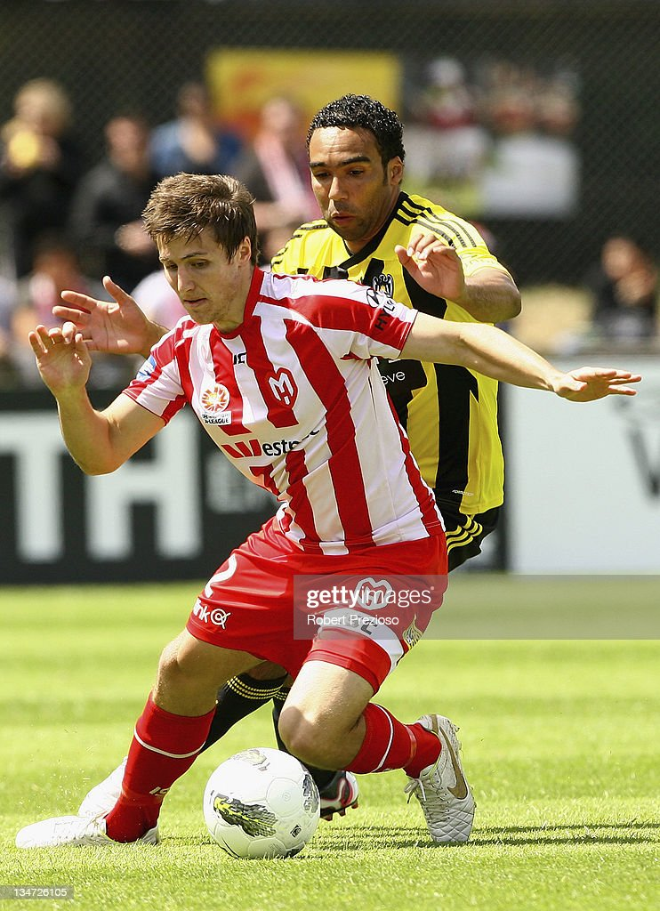 Paul Ifill of the Phoenix and Michael Marrone of the Heart contest the ball during the round nine A-League match between the Melbourne Heart and the Wellington Phoenix at Latrobe City Sports & Entertainment Complex on December 4, 2011 in Melbourne, Australia.