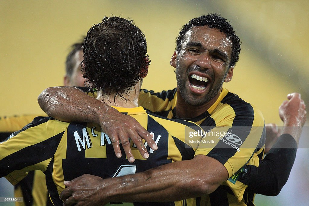 Paul Ifill of the Phoenix celebrates a goal with team mate Jonathan McKain during the round 23 A-League match between the Wellington Phoenix and North Queensland Fury at Westpac Stadium on January 15, 2010 in Wellington, New Zealand.