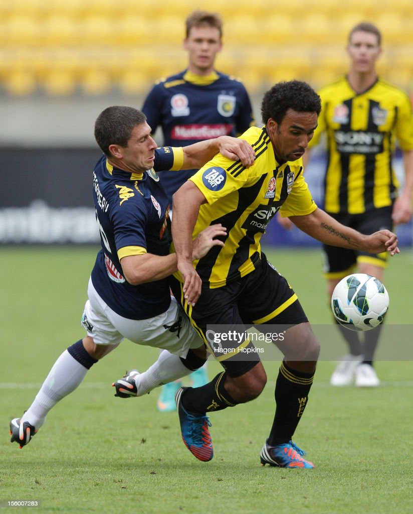 Paul Ifill of the Phoenix evades the defence of Nick Montgomery of the Mariners during the round six A-League match between the Wellington Phoenix and the Central Coast Mariners at Westpac Stadium on November 11, 2012 in Wellington, New Zealand.