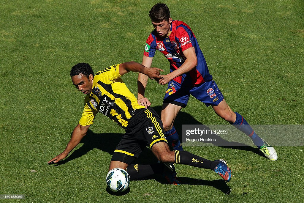 Paul Ifill of the Phoenix goes to ground in the tackle of Scott Neville of the Jets during the round 18 A-League match between the Wellington Phoenix and the Newcastle Jets at Westpac Stadium on January 27, 2013 in Wellington, New Zealand.