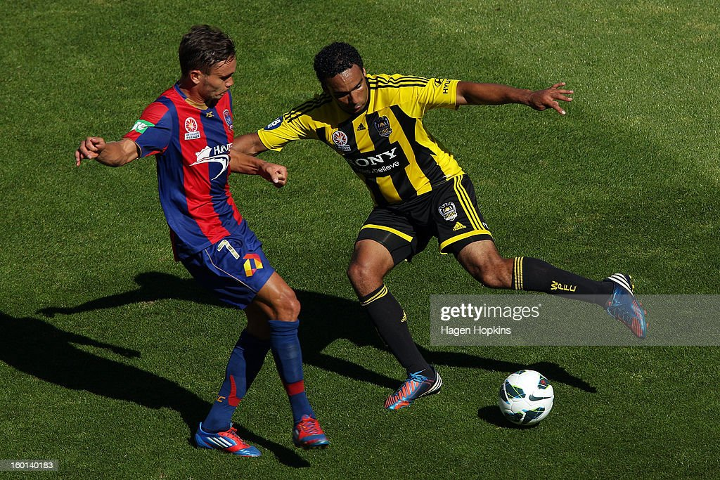 Paul Ifill of the Phoenix holds off the defence of James Brown of the Jets during the round 18 A-League match between the Wellington Phoenix and the Newcastle Jets at Westpac Stadium on January 27, 2013 in Wellington, New Zealand.