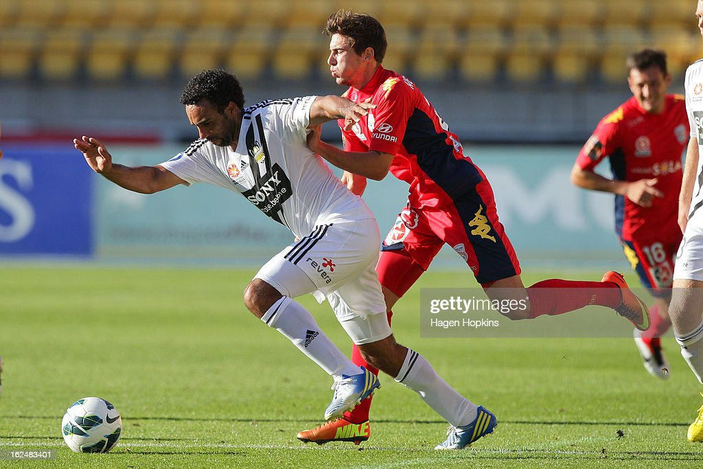 Paul Ifill of the Phoenix is challenged by Evan Kostopoulos of Adelaide during the round 22 A-League match between the Wellington Phoenix and Adelaide United at Westpac Stadium on February 24, 2013 in Wellington, New Zealand.