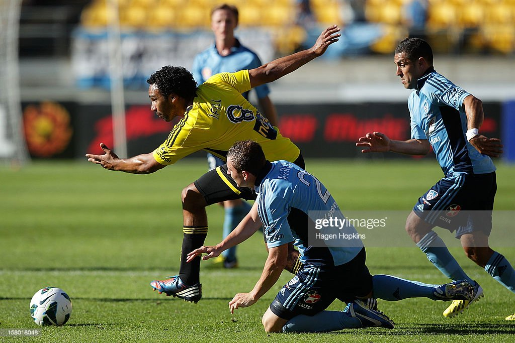 Paul Ifill of the Phoenix makes a break past the challenge of Sebastian Ryall of Sydney FC during the round 10 A-League match between Wellington Phoenix and Sydney FC at Westpac Stadium on December 9, 2012 in Wellington, New Zealand.