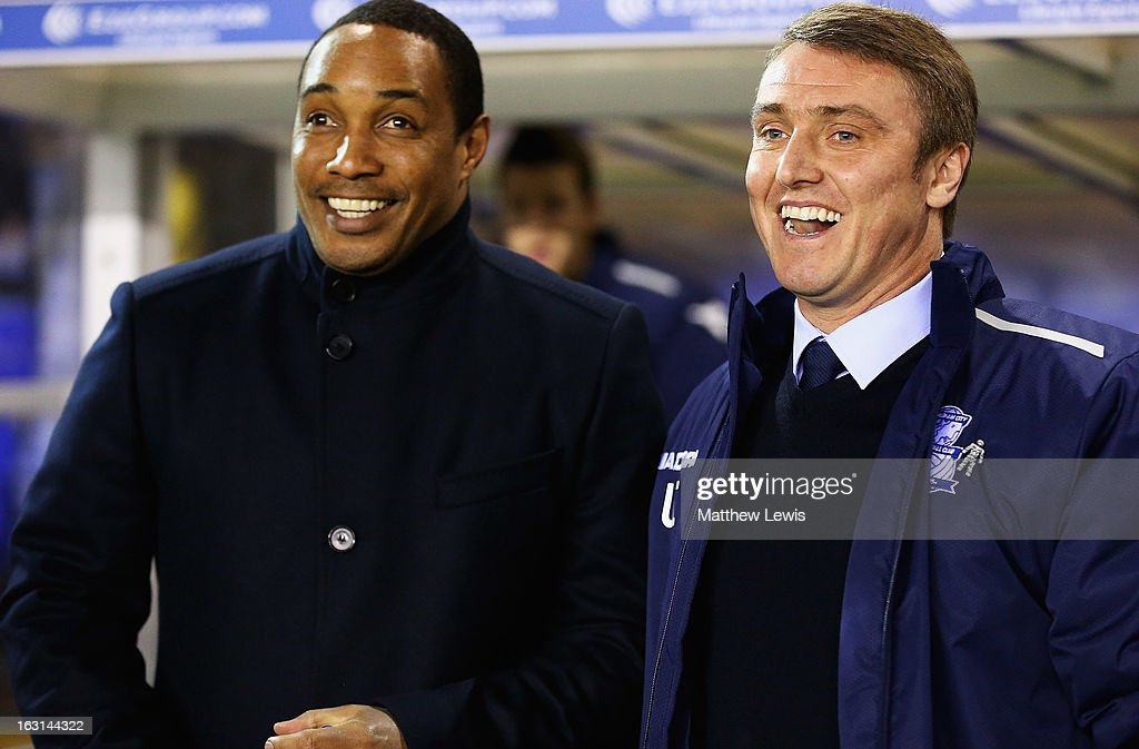 Paul Ince, manager of Blackpool and Lee Clark, manager of Birmingham City share a joke ahead of the npower Championship match between Birmingham City and Blackpool at St Andrews on March 5, 2013 in Birmingham, England.