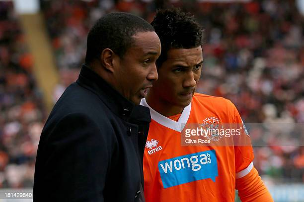Paul Ince of Blackpool speaks with son Tom Ince prior to kick off in the Sky Bet Championship match between Blackpool and Leicester City at...