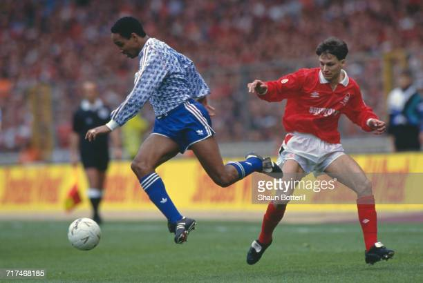 Paul Ince of Manchester Utd holds onto the ball from the Nottingham Forest defender Gary Crosby during their Rumbelows Football League Cup Final...