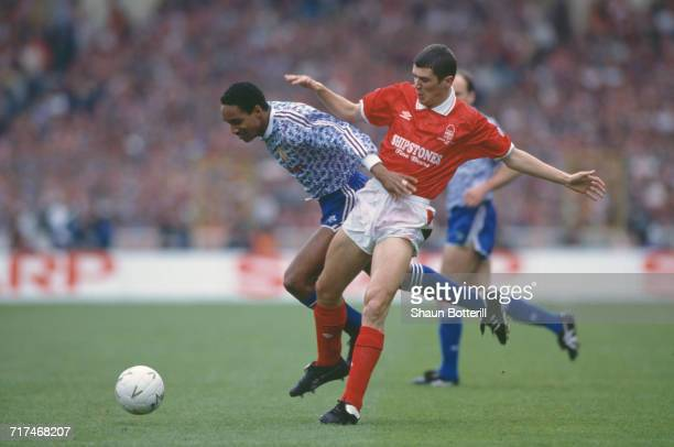 Paul Ince of Manchester Utd holds onto the ball from the Nottingham Forest defender Roy Keane during their Rumbelows Football League Cup Final match...